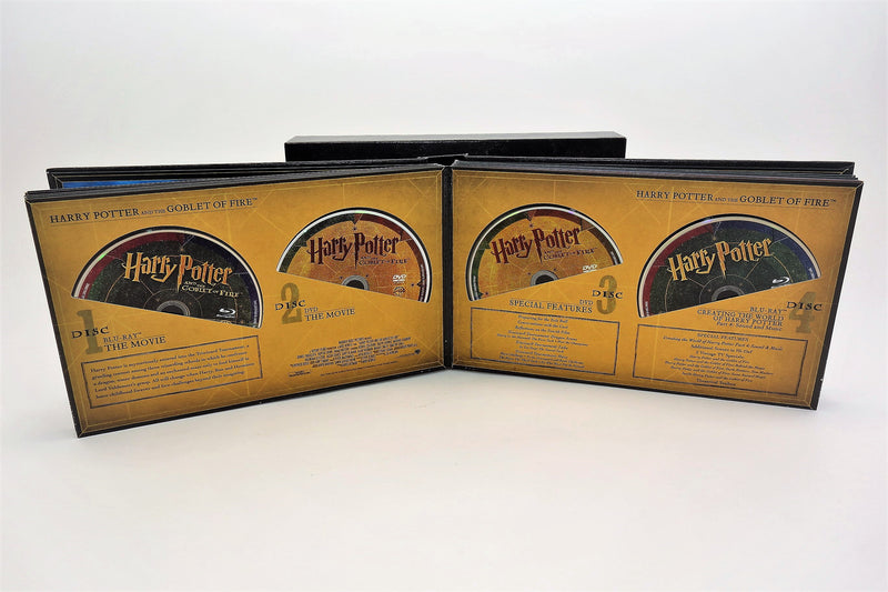 Album opened to Goblet of Fire page and four discs