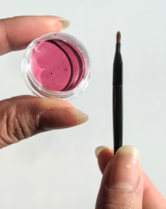 Pink lipstick tester with brush