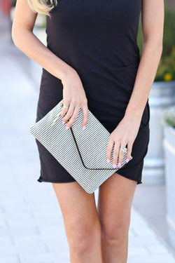 woman in black with clutch