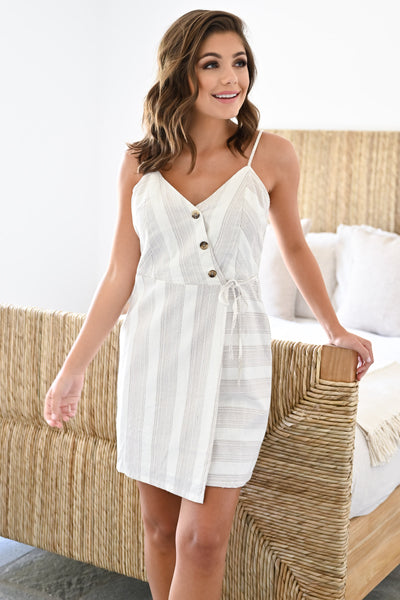 See You On The Flip Side Dress - Ivory womens trendy striped wrap dress with buttons closet candy front 2; Model: Hannah Sluss