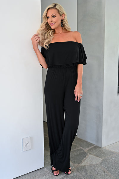 Here For The Party Jumpsuit - Black womens trendy off the shoulder ruffle detail jumper closet candy front 1