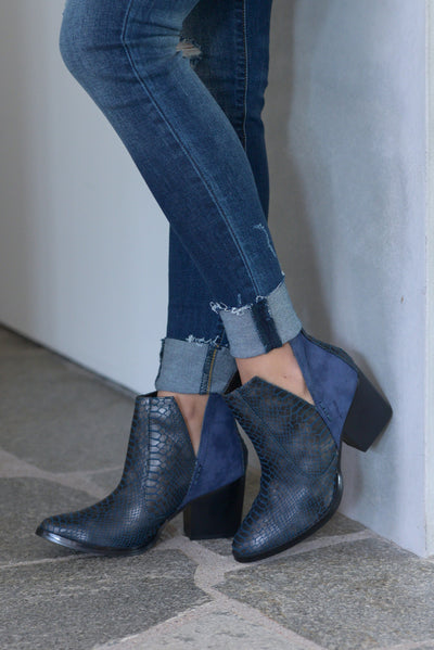 Laura Marano Tarim Booties - Navy Not Rated women's snake print textured, vegan leather, heeled ankle booties with v-cutouts on sides closet candy boutique 1
