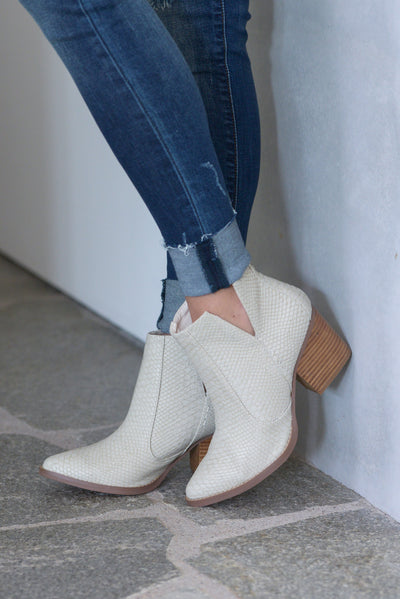 Laura Marano Booties - Cream Not Rated women's snake print textured, vegan leather, heeled ankle booties, v-cutouts on sides closet candy boutique 1