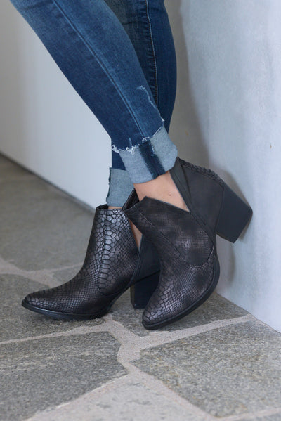 Laura Marano Tarim Booties - Black Not Rated snake print textured, vegan leather, heeled ankle booties with v-cutouts on sides closet candy boutique 1