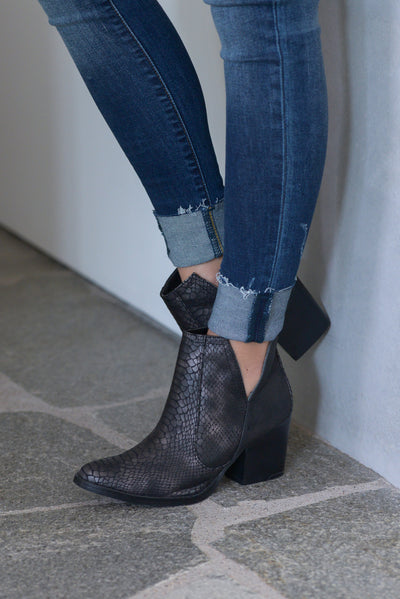 Laura Marano Booties - Black Not Rated snake print textured, vegan leather, heeled ankle booties with v-cutouts on sides closet candy boutique 3
