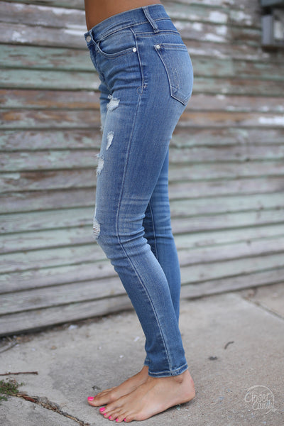 Judy Blue Distressed Skinny Jeans - faded wash distressed mid rise jeans, side, Closet Candy Boutique