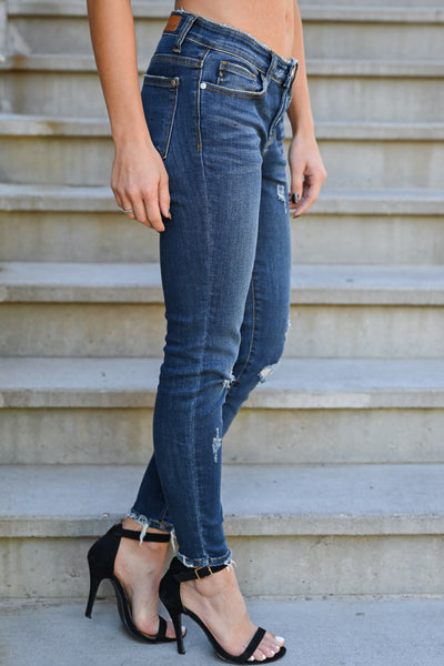 JUDY BLUE Delanie Distressed Skinntresy Jeans - Dark Wash womens trendy dark wash mid-rise distressed jeans closet candy side
