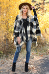 Date in the Mountains Buffalo Plaid Poncho - Ivory & Black womens trendy plaid poncho fringe trim closet candy front 2
