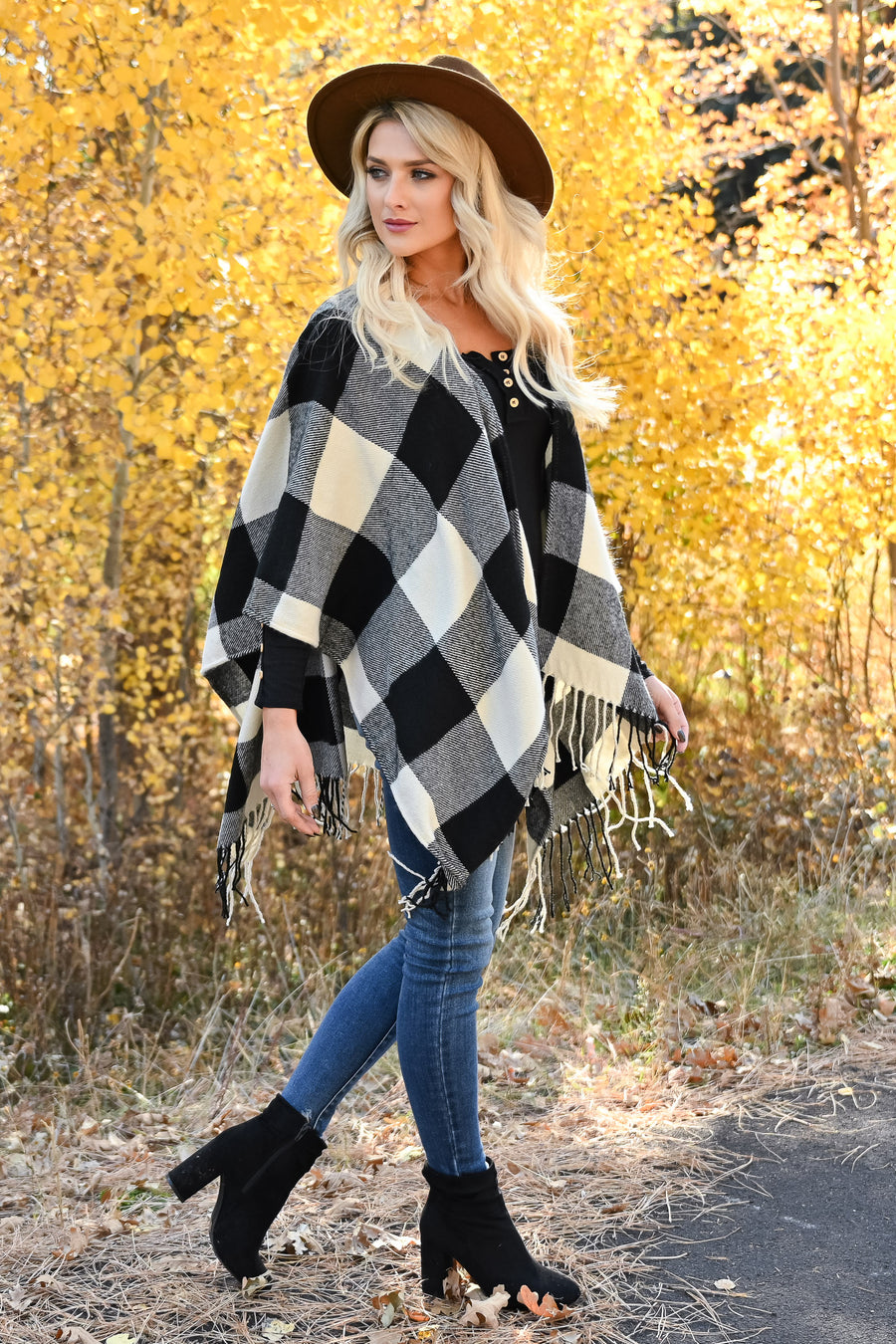 Date in the Mountains Buffalo Plaid Poncho - Ivory & Black womens trendy plaid poncho fringe trim closet candy front