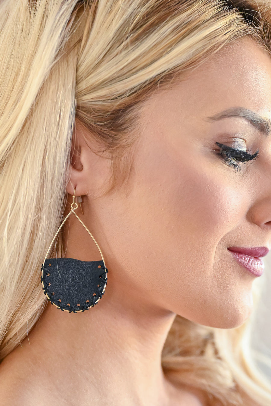 Carry On Teardrop Earrings - Black women trendy vegan leather teardrop earrings stitching detail closet candy side