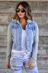 Her Good Side Hooded Denim Jacket - Light Wash women's hooded denim jacket featuring basic collar, heather grey contrast at sleeves and hood, side pockets, front button closure, and chest pockets with flap and button closure. Hood can be removed closet candy close up