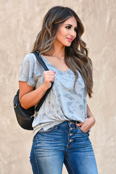 Weekend Wait Burnout Top - Grey Women's grey burnout top featuring rounded v-neckline, short sleeves, side split hem design, and raw edge detailing. Semi-sheer closet candy front