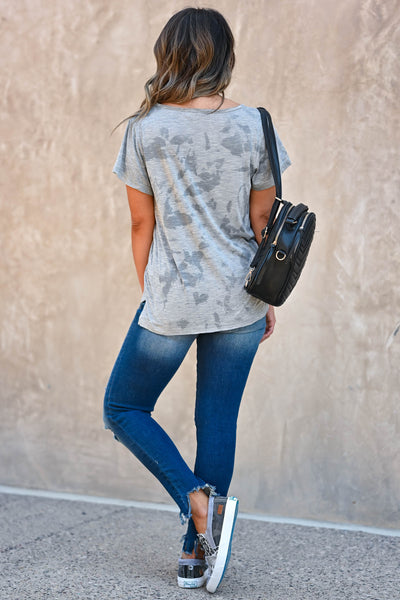 Weekend Wait Burnout Top - Grey Women's grey burnout top featuring rounded v-neckline, short sleeves, side split hem design, and raw edge detailing. Semi-sheer closet candy back