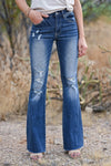 Chloe Distressed Raw Hem Flare Jeans - Dark Wash womens trendy distressed flare jeans closet candy front 2