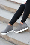 Gone For Now Wedge Sneakers - Grey women's wedge slip-on sneakers with elastic band and cutout details at sides. A wedge sole hides under the sneaker's casual exterior, creating an ultra-flattering limb-lengthening illusion closet candy side
