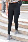 Moving Quicker Moto Leggings - Black women's high-waisted moto leggings featuring pin tuck details, elastic band at waist, and buttery-soft material closet candy close up