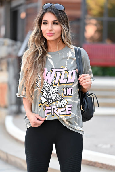 """Wild and Free"" Tie Dye Graphic Tee - Grey women's short sleeve tee featuring round neckline, cuffed sleeves, and ""Wild and Free"" graphic on front closet candy close up"