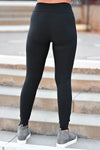 Moving Quicker Moto Leggings - Black women's high-waisted moto leggings featuring pin tuck details, elastic band at waist, and buttery-soft material closet candy back