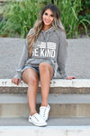 "Be Anything Be Kind Graphic Hoodie - Vintage Grey women's fleece-lined hoodie featuring drawstring hood, reverse stitching detail at neckline, kangaroo pocket, banded cuffs and hem, exposed raw edge seams, and ""In A World Where You Can Be Anything, Be Kind"" graphic on front closet candy sitting 2"