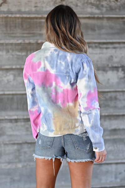 Sunset Walks Tie Dye Denim Jacket - Multi Women's tie-dye denim jacket featuring basic collar, long sleeves, button closure at front and at cuffs, and chest pockets with flap and button closure closet candy back