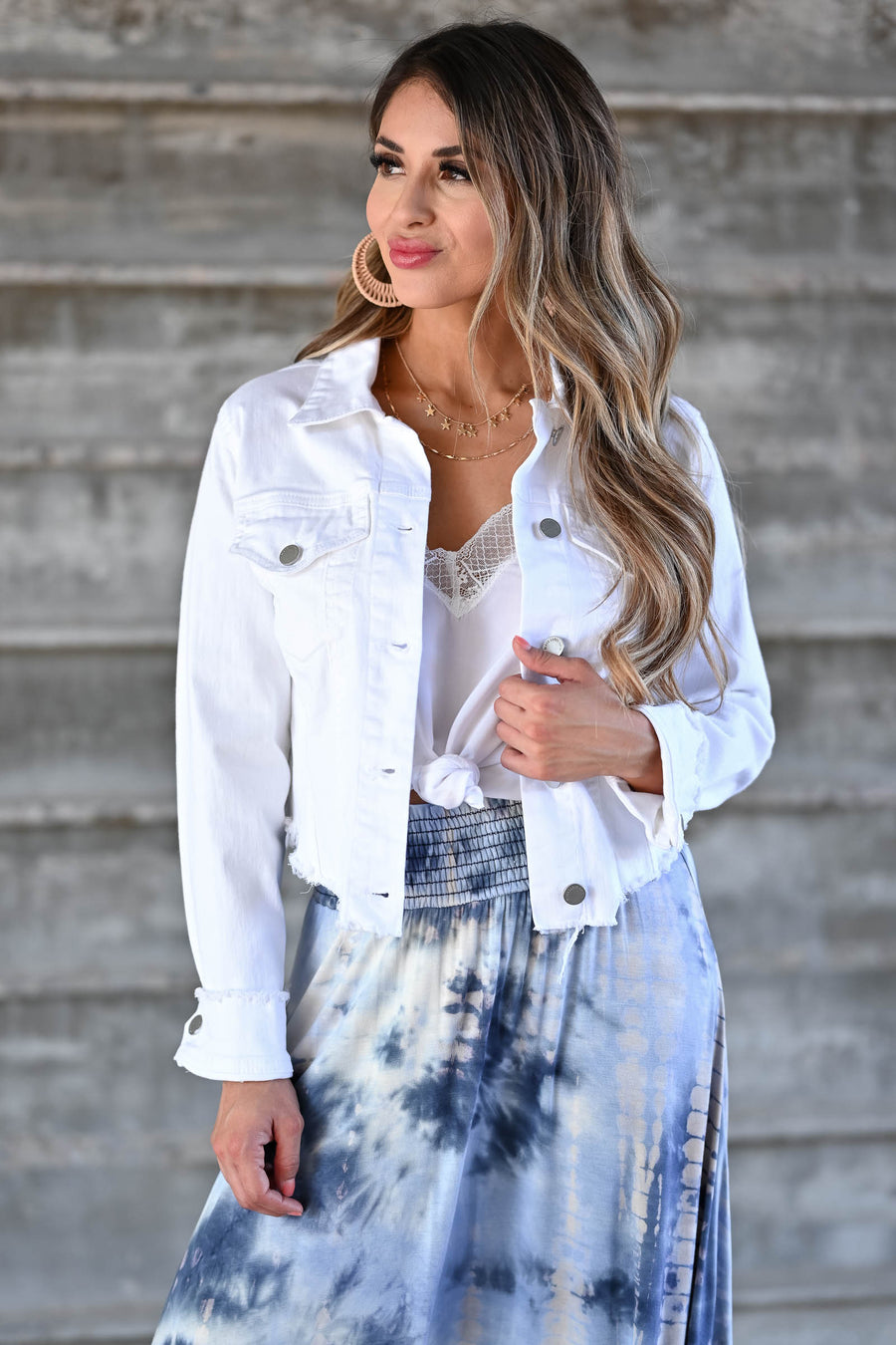 Own It Denim Jacket W/ Raw Hem - White Women's white denim jacket featuring basic collar, long sleeves, raw hem design, button closure at front and cuffs, and chest pockets with flap button closure closet candy front