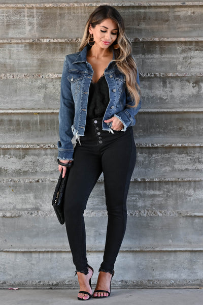 Own It Denim Jacket W/ Raw Hem - Dark Wash Women's dark wash denim jacket featuring basic collar, long sleeves, raw hem design, button closure at front and cuffs, and chest pockets with flap button closure closet candy front