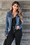 Own It Denim Jacket W/ Raw Hem - Dark Wash Women's dark wash denim jacket featuring basic collar, long sleeves, raw hem design, button closure at front and cuffs, and chest pockets with flap button closure closet candy close up