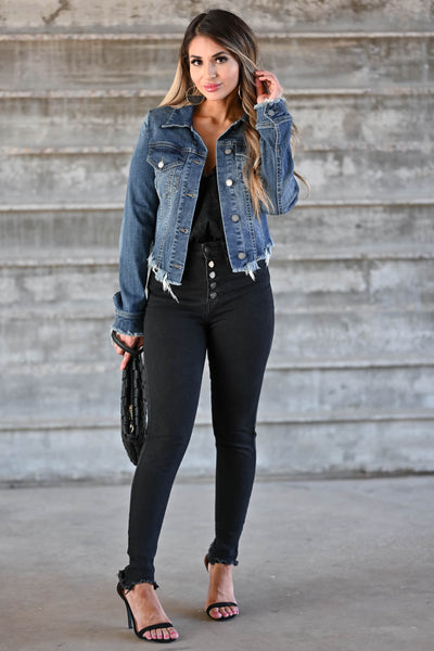 Own It Denim Jacket W/ Raw Hem - Dark Wash Women's dark wash denim jacket featuring basic collar, long sleeves, raw hem design, button closure at front and cuffs, and chest pockets with flap button closure closet candy front 2