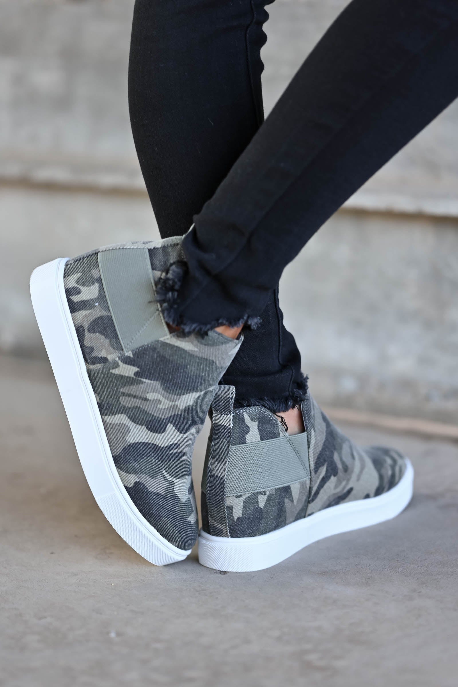 Gone For Now Wedge Sneakers - Camo omen's wedge slip-on sneakers with elastic band and cutout details at sides. A wedge sole hides under the sneaker's casual exterior, creating an ultra-flattering limb-lengthening illusion closet candy side