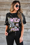 """Wild and Free"" Tie Dye Graphic Tee - Black women's short sleeve tee featuring round neckline, cuffed sleeves, and ""Wild and Free"" graphic on front closet candy close up"
