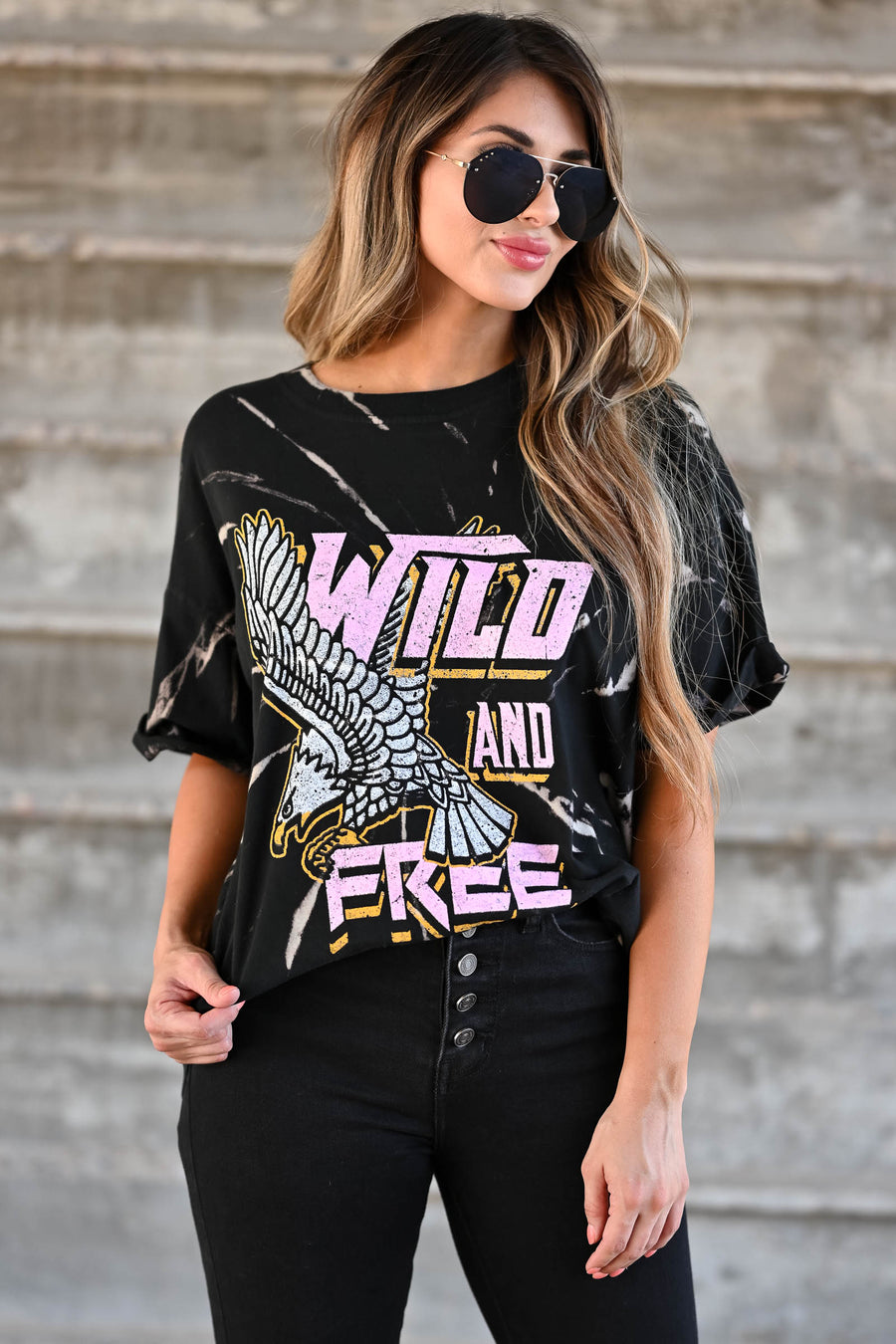"""Wild and Free"" Tie Dye Graphic Tee - Black women's short sleeve tee featuring round neckline, cuffed sleeves, and ""Wild and Free"" graphic on front closet candy front"