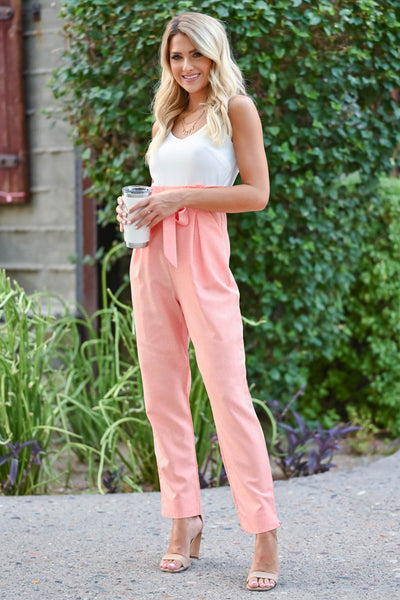 Girl's Getaway Jumpsuit - Coral Coral and ivory jumpsuit with scoop neckline, adjustable spaghetti straps, and side pockets. Bow can be tied in the front or back closet candy front 3