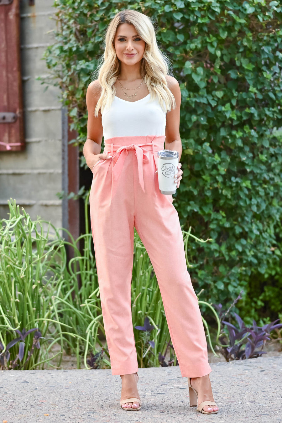 Girl's Getaway Jumpsuit - Coral Coral and ivory jumpsuit with scoop neckline, adjustable spaghetti straps, and side pockets. Bow can be tied in the front or back closet candy front