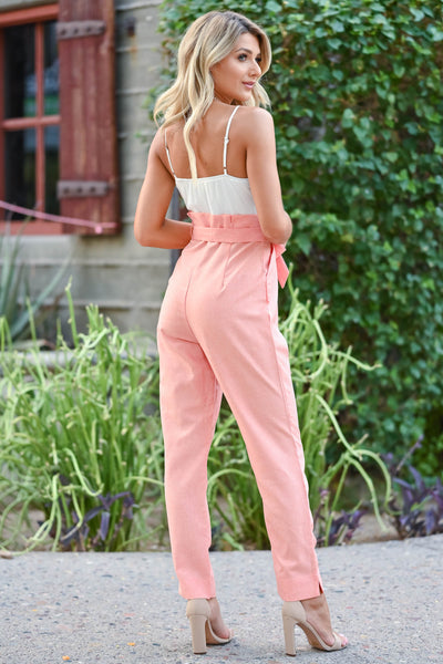 Girl's Getaway Jumpsuit - Coral Coral and ivory jumpsuit with scoop neckline, adjustable spaghetti straps, and side pockets. Bow can be tied in the front or back closet candy back