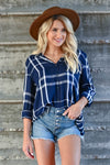 THREAD & SUPPLY Catch My Drift Top - Navy women's plaid button-up top featuring basic collar, high-low hem design, pleated crossover detail at back, and long sleeves with button cuff and roll tab option closet candy close up