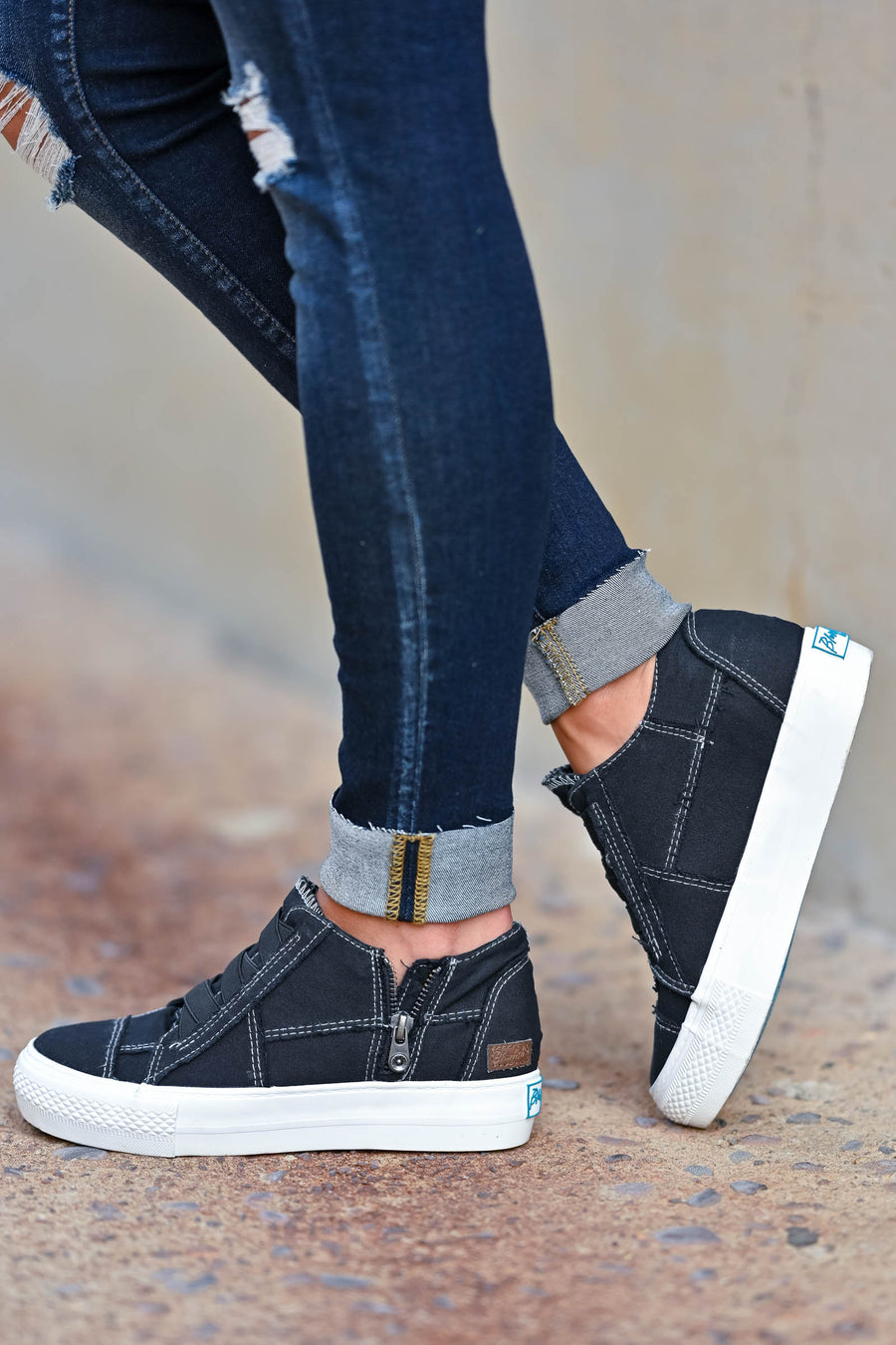 Walk That Way Wedge Sneaker - Black omen's wedge sneakers featuring elastic ribbon design, exposed seam details, side zipper, and padded insole. A wedge sole hides under the sneaker's casual exterior, creating an ultra-flattering limb-lengthening illusion closet candy side