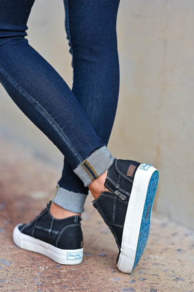 Walk That Way Wedge Sneaker - Black omen's wedge sneakers featuring elastic ribbon design, exposed seam details, side zipper, and padded insole. A wedge sole hides under the sneaker's casual exterior, creating an ultra-flattering limb-lengthening illusion closet candy back