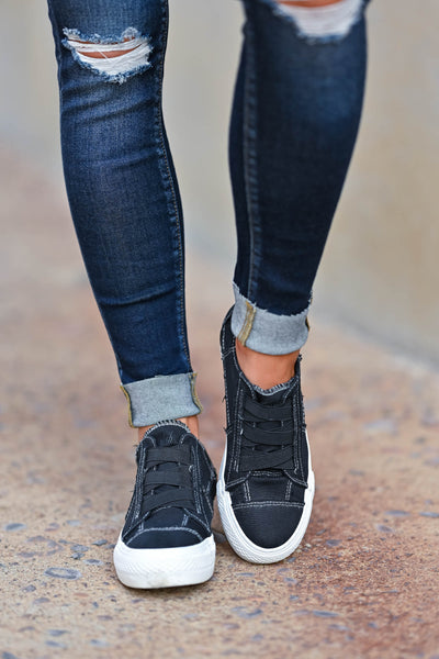 Walk That Way Wedge Sneaker - Black omen's wedge sneakers featuring elastic ribbon design, exposed seam details, side zipper, and padded insole. A wedge sole hides under the sneaker's casual exterior, creating an ultra-flattering limb-lengthening illusion closet candy front