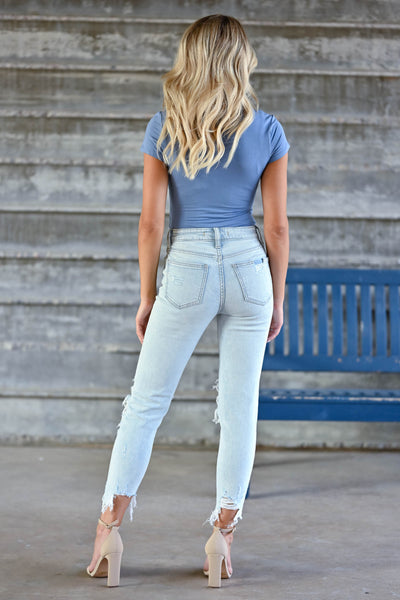 Peyton Cropped Distressed Jeans - Light Wash women's distressed jeans featuring cropped length, distressed raw hem, classic 5-pocket design, and zipper fly with button closure closet candy back