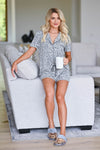 Sleep Well Leopard Pajamas - Grey women's leopard print pajama loungewear. Top features collared v-neckline, shorts sleeves, chest pocket, and button closure at front. Matching shorts feature elastic drawstring waistband closet candy sitting 2