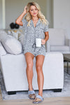 Sleep Well Leopard Pajamas - Grey women's leopard print pajama loungewear. Top features collared v-neckline, shorts sleeves, chest pocket, and button closure at front. Matching shorts feature elastic drawstring waistband closet candy sitting