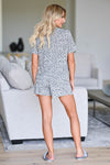 Sleep Well Leopard Pajamas - Grey women's leopard print pajama loungewear. Top features collared v-neckline, shorts sleeves, chest pocket, and button closure at front. Matching shorts feature elastic drawstring waistband closet candy back