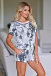 Stormy Skies Tie Dye Loungewear - Ivory & Charcoal Women's tie-dye loungewear top and shorts. Top features short sleeves and round neckline with raw edge detailing. Matching lounge shorts feature side pockets and elastic waistband with decorative self-tie detail. Fabric is soft and comfortable closet candy close up
