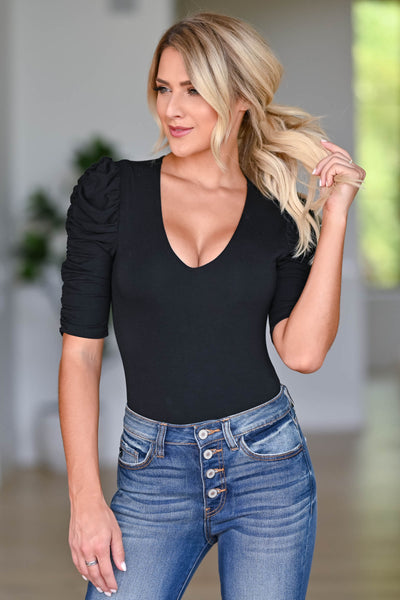 Here To There Double Layer Bodysuit - Black women's double layer bodysuit featuring plunging v-neckline, ruched sleeves, and snap button closure at bottom. *Cheeky/thong bottom coverage closet candy close up