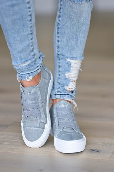 Walk That Way Wedge Sneaker - Grey women's wedge sneakers featuring elastic ribbon design, exposed seam details, side zipper, and padded insole. A wedge sole hides under the sneaker's casual exterior, creating an ultra-flattering limb-lengthening illusion closet candy front
