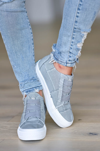 Walk That Way Wedge Sneaker - Grey women's wedge sneakers featuring elastic ribbon design, exposed seam details, side zipper, and padded insole. A wedge sole hides under the sneaker's casual exterior, creating an ultra-flattering limb-lengthening illusion closet candy front 2