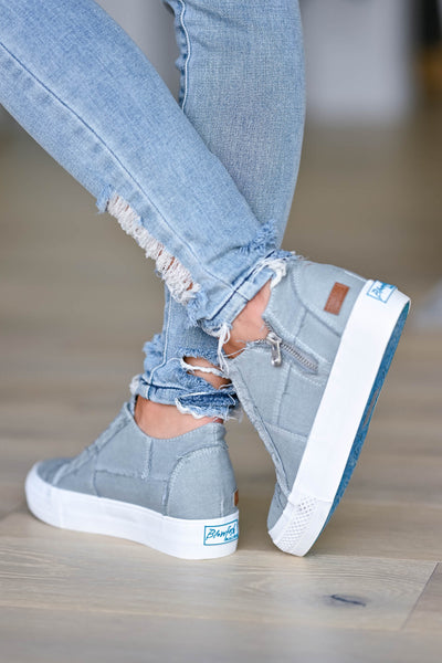 Walk That Way Wedge Sneaker - Grey women's wedge sneakers featuring elastic ribbon design, exposed seam details, side zipper, and padded insole. A wedge sole hides under the sneaker's casual exterior, creating an ultra-flattering limb-lengthening illusion closet candy back