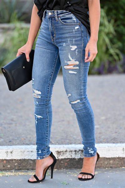 VERVET Monica Distressed Skinny Jeans - Medium Wash women's distressed skinny jeans with classic 5-pocket design and zipper fly with button closure. High-rise style. Distressing may vary. Can be worn cuffed or uncuffed closet candy side