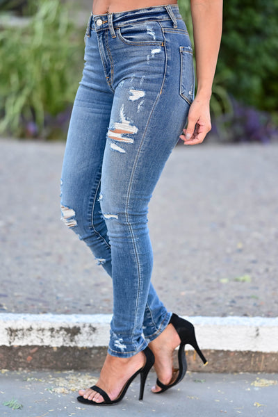 VERVET Monica Distressed Skinny Jeans - Medium Wash women's distressed skinny jeans with classic 5-pocket design and zipper fly with button closure. High-rise style. Distressing may vary. Can be worn cuffed or uncuffed closet candy side 2
