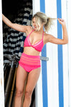 Cabana Life Bikini - Neon Pink womens Bikini top features self-tie back and light removable padding. Matching high waisted bikini bottoms with mesh panels and pom pom details. Moderate coverage closet candy front